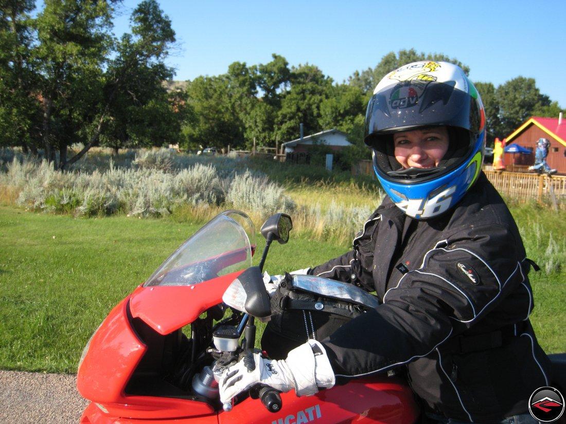 Pretty girl ridng a Ducati Multistrada