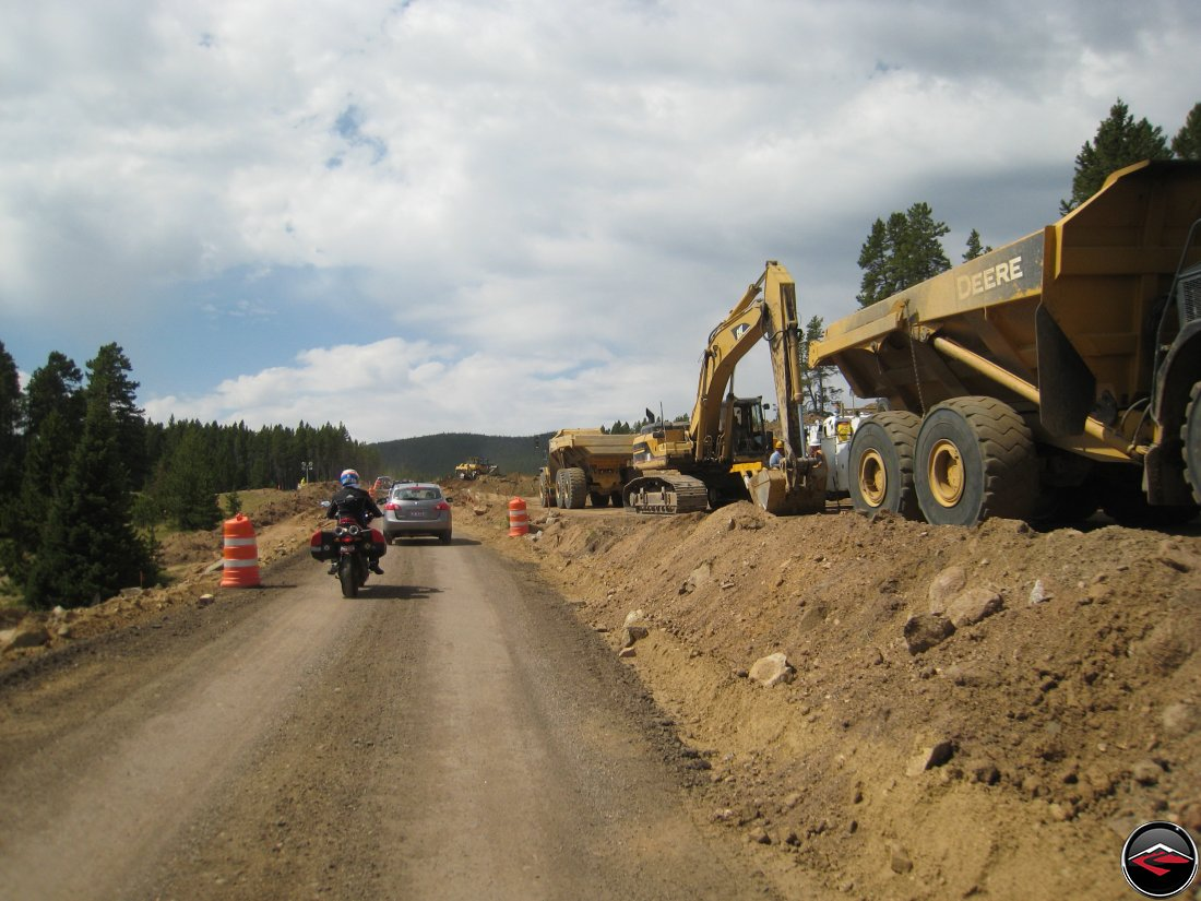 Ducati Mulitistrada Motorcycle riding through construction and past heavy equipment on the top of the Big Horn Mountains