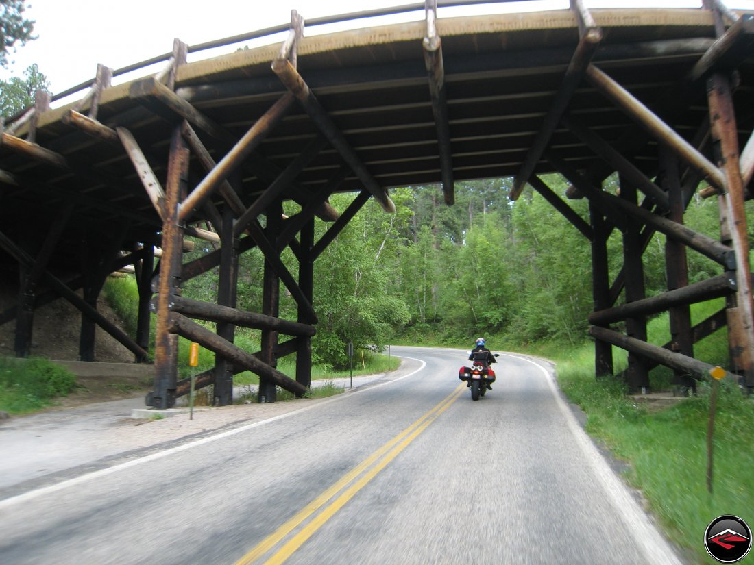Ducati Multistrada Motorcycle Riding through the Pigtail Bridges on the Norbeck Scenic Byway in South Dakota
