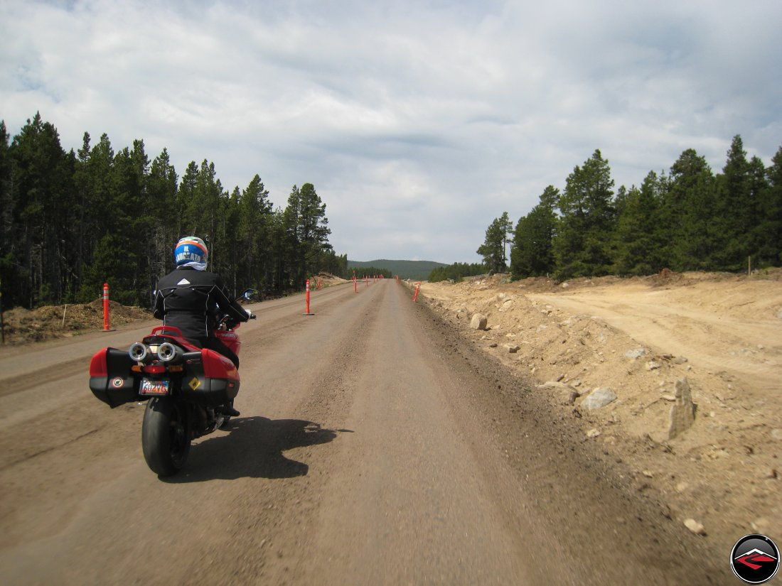 Ducati Mulitistrada Motorcycle riding through road construction in the Big Horn Mountains