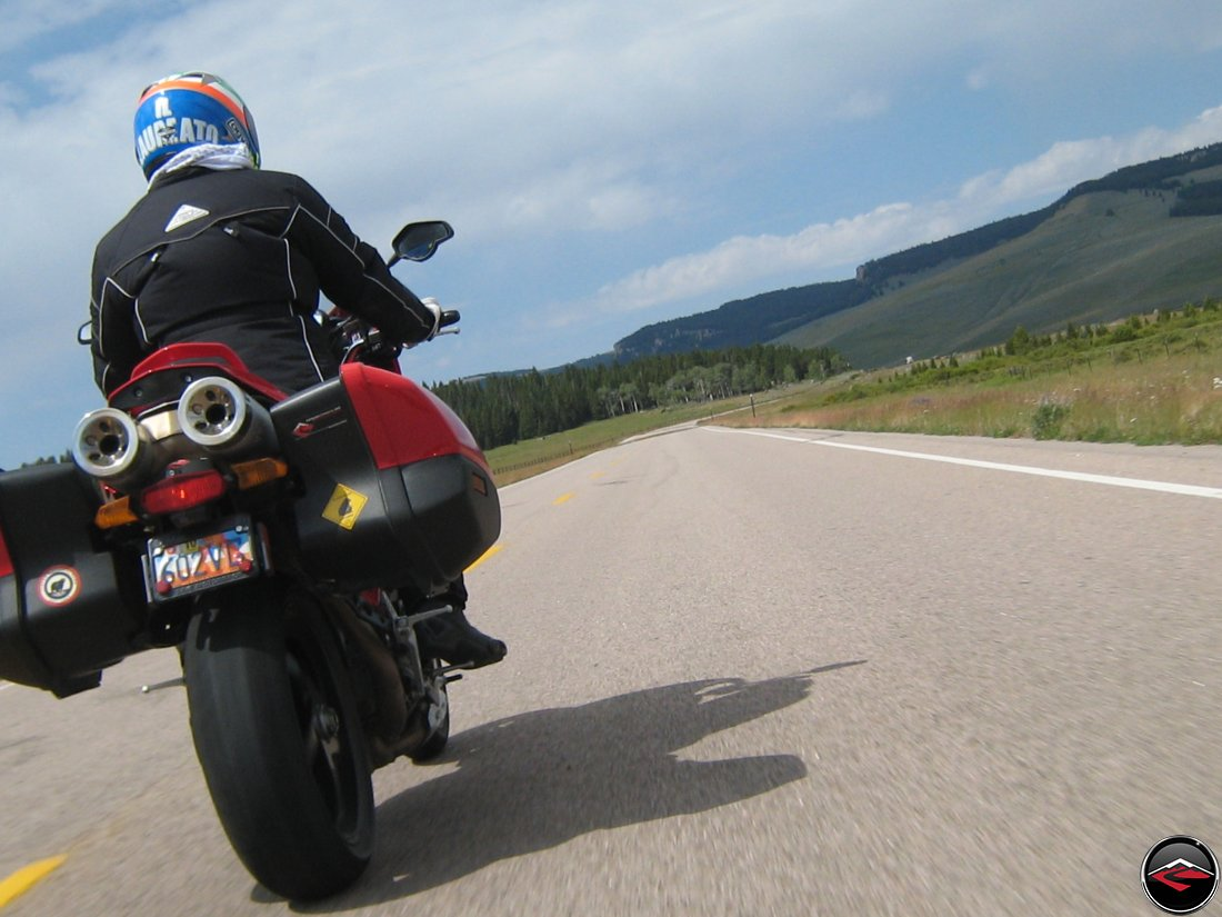 Ducati Mulitistrada Motorcycle riding through sweeping corners in the Big Horn Mountains