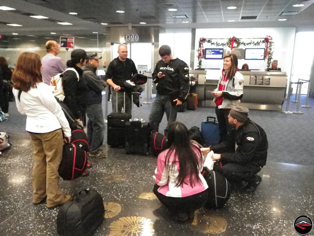Group gathering together in the very, very cold Miami airport
