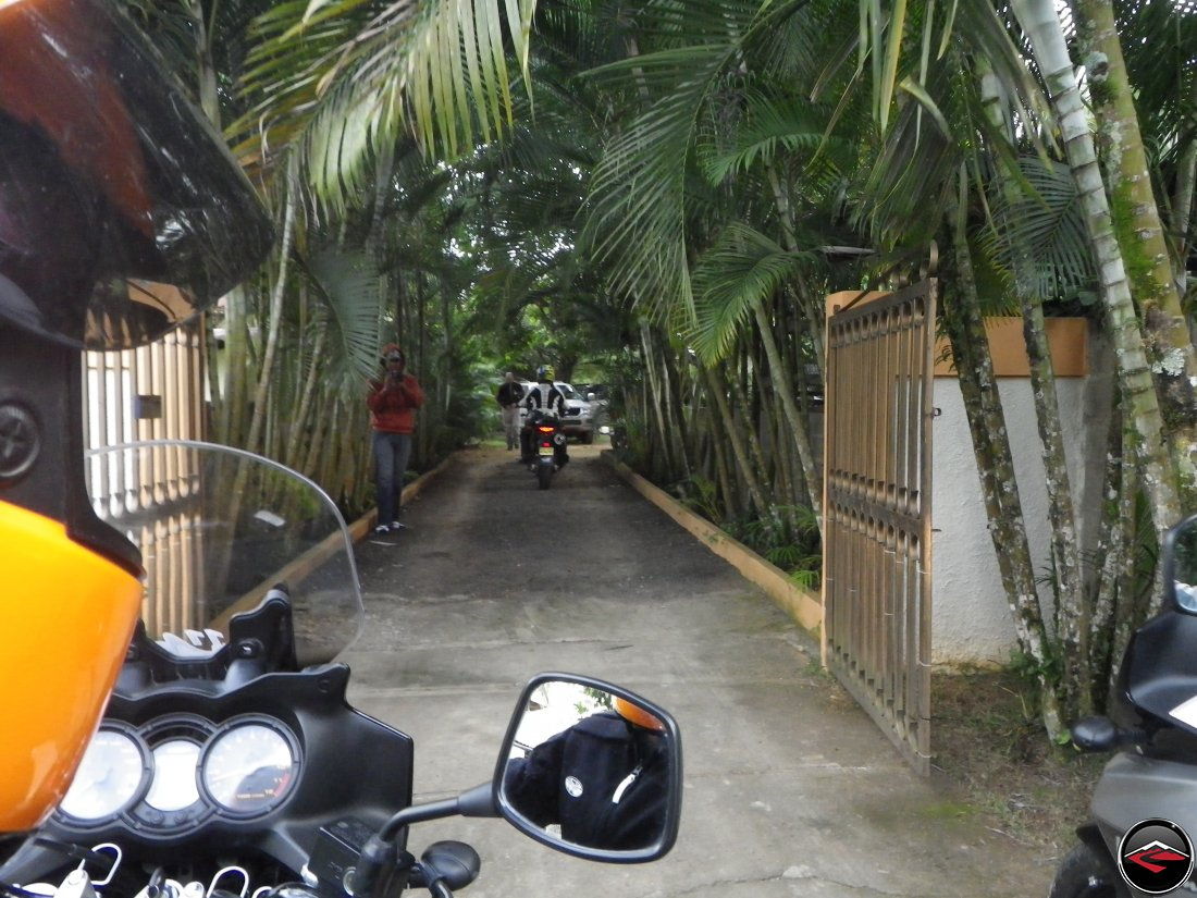 Leaving the compound in Jarabacoa on Suzuki V-Strom 650s, including riding past the steel driveway gate