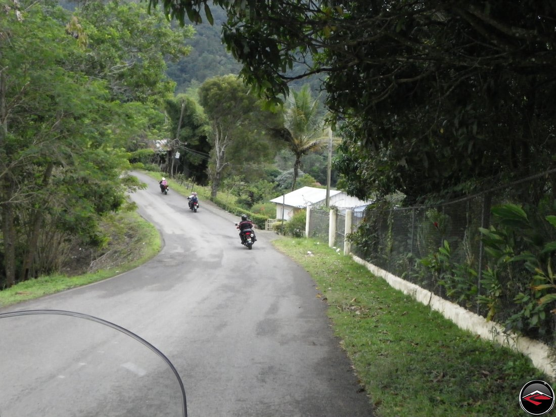 Riding motorcycles through a downhill, sweeping corner