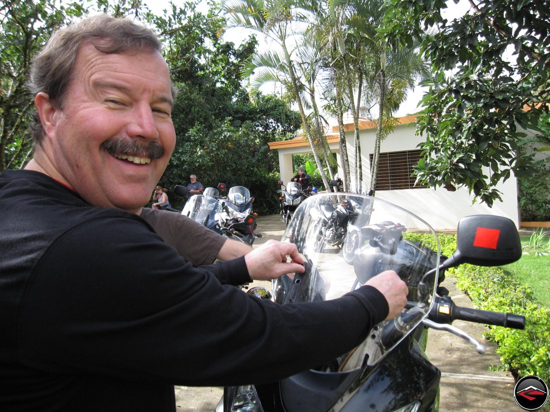Don lowering the windshield on his Suzuki V-Strom 650