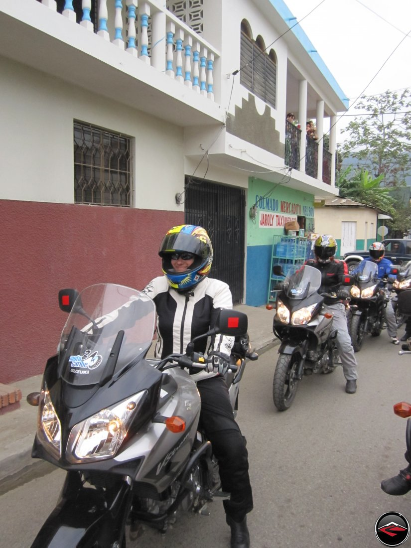 Riding motorcycles through the narrow, conjested streets of Jarabacoa, Dominican Republic