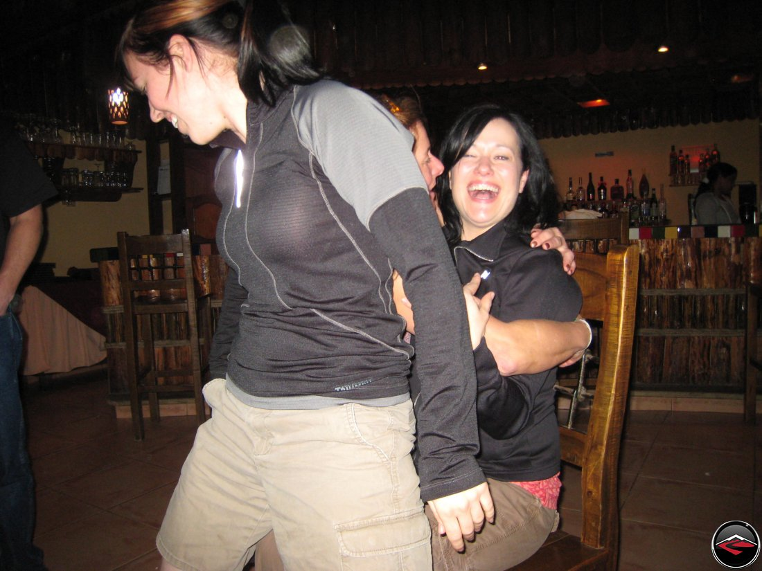 girl giving a lap dance to another girl for her birthday