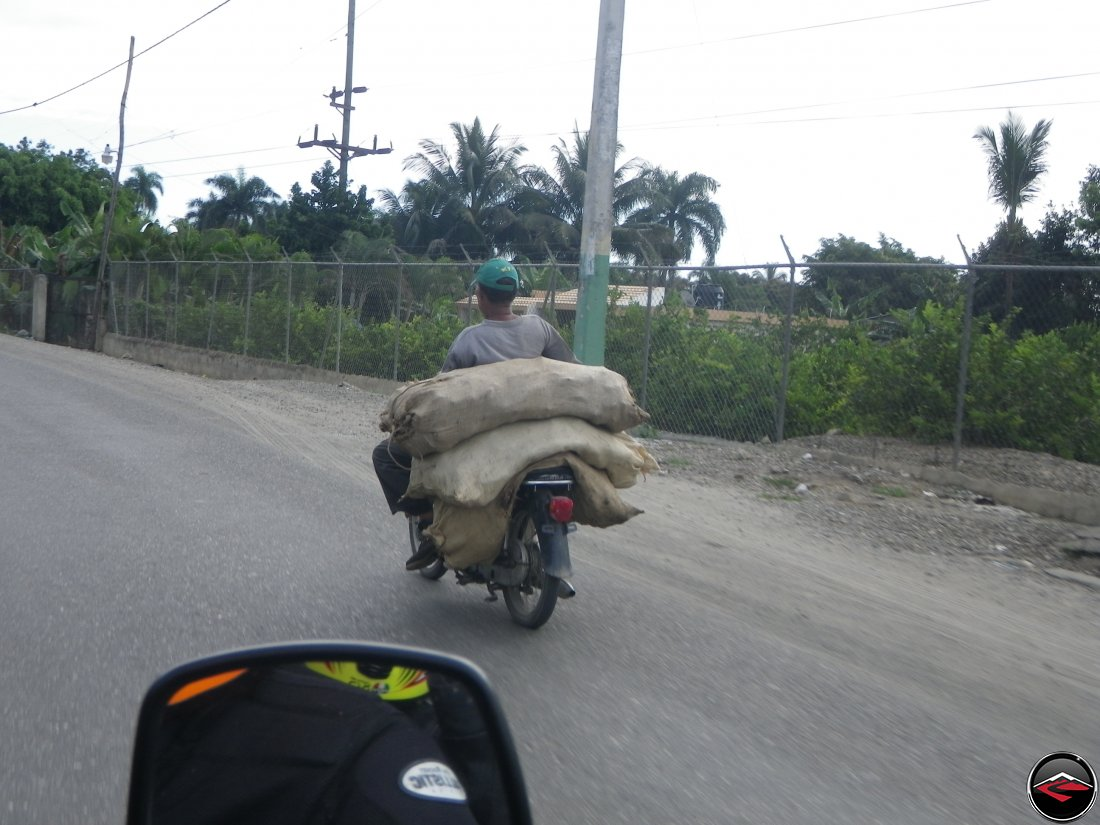 Third world motorcycle hauling a heavy load of sacks in the Dominican Republic - Bikes of Burden