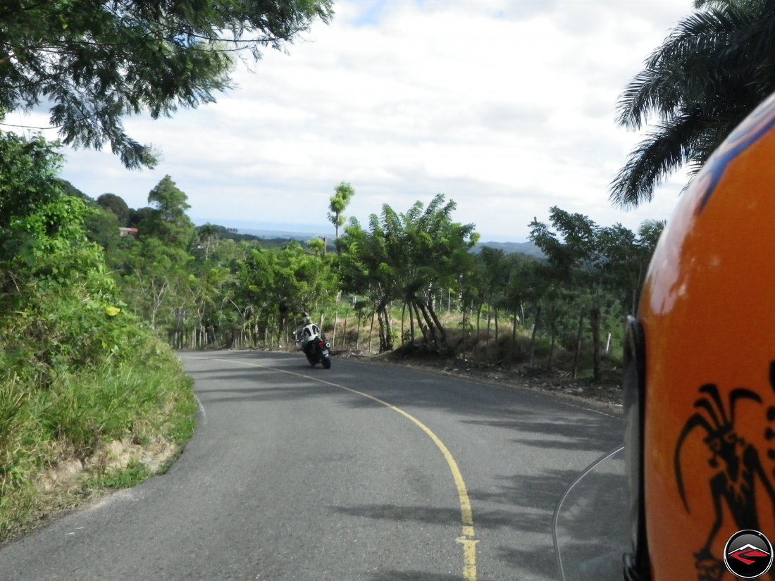 Riding motorcycles along Highway 21 that follows the ridge towards Sabaneta de Yasica Dominican Republic