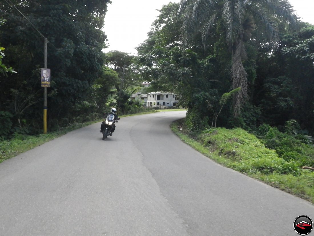 Riding a motorcycle through a sweeping bend on perfect asphalt on Highway 5 on the north coast of the Dominican Republic