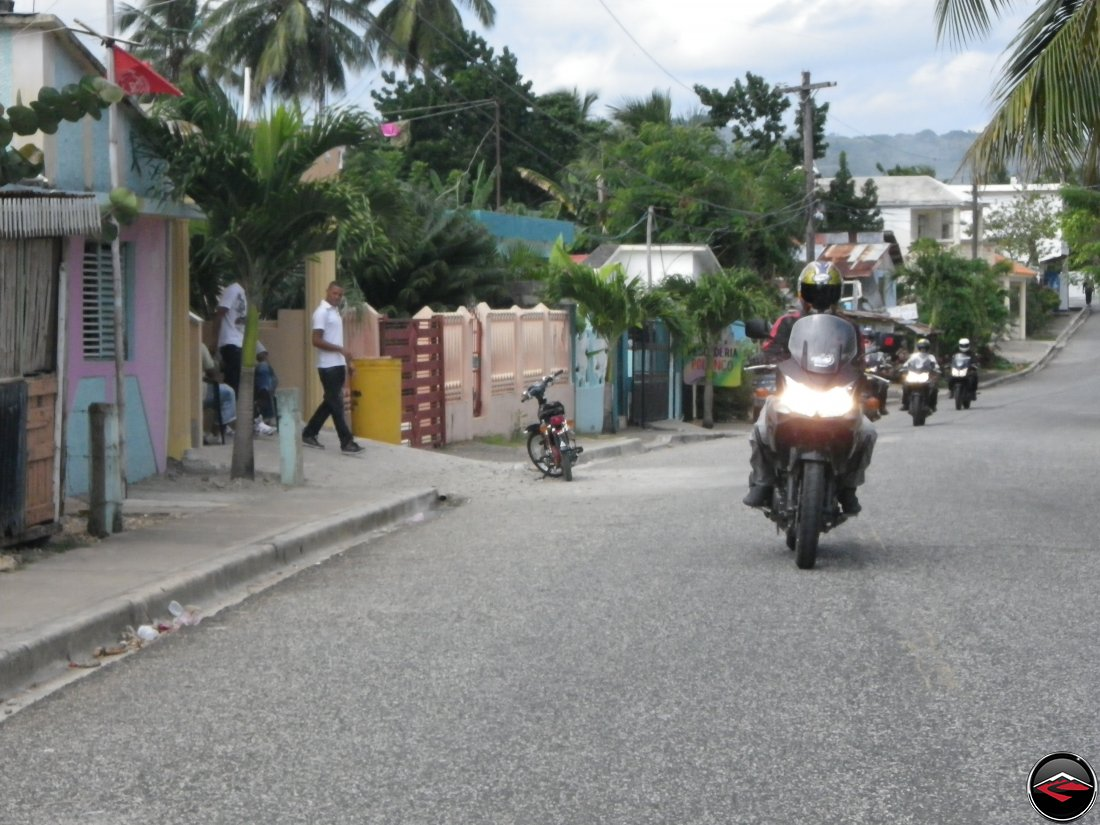 Riding motorcycles on Highway 5 through Gaspar Hernandez Dominican Republic