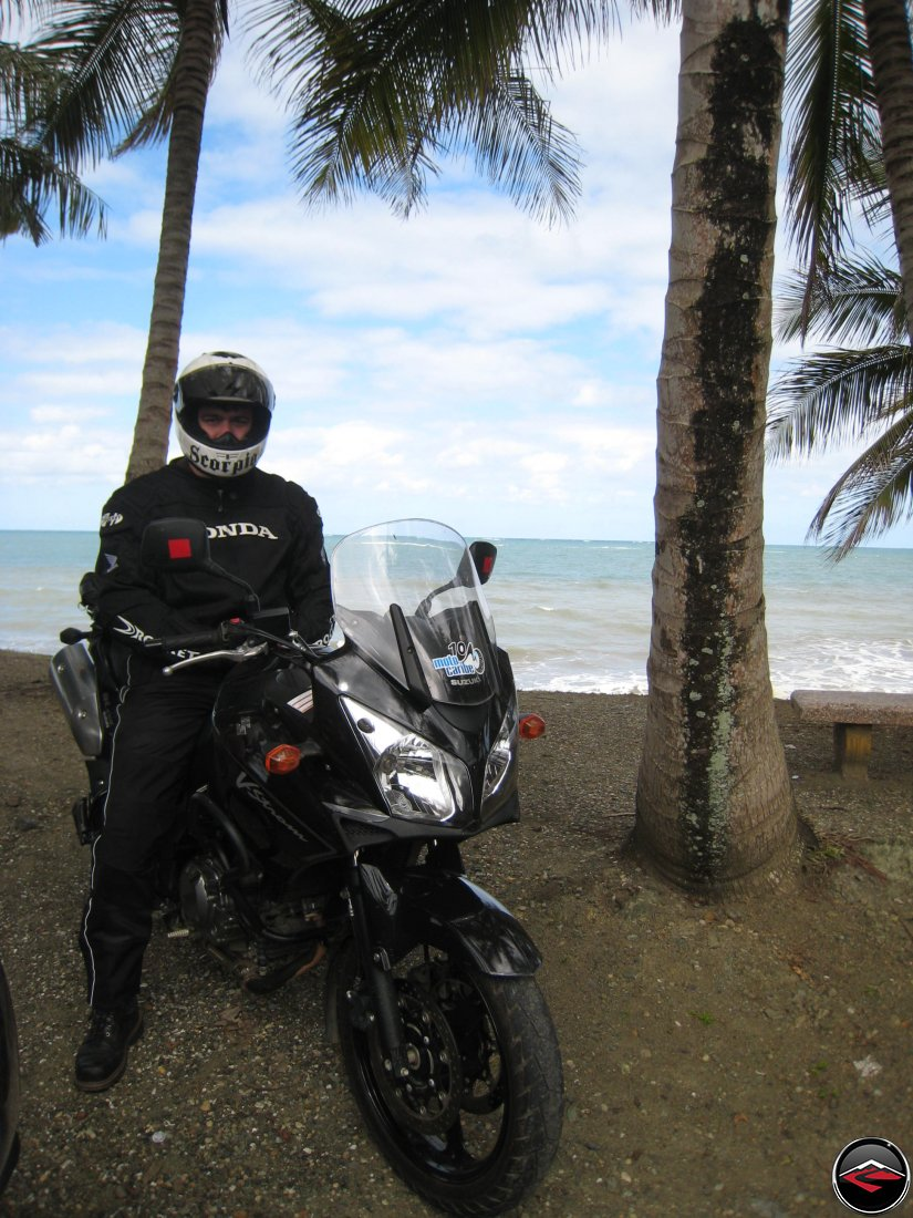 Warren wearing a Scorpion Helmet and wearing a Honda coat while on his Suzuki V-Strom 650