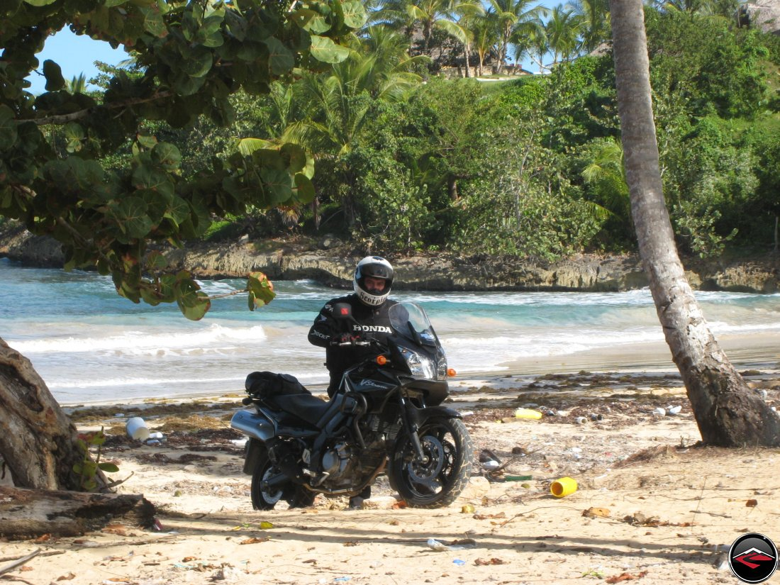 Man with motorcycle on the beach in the caribbean