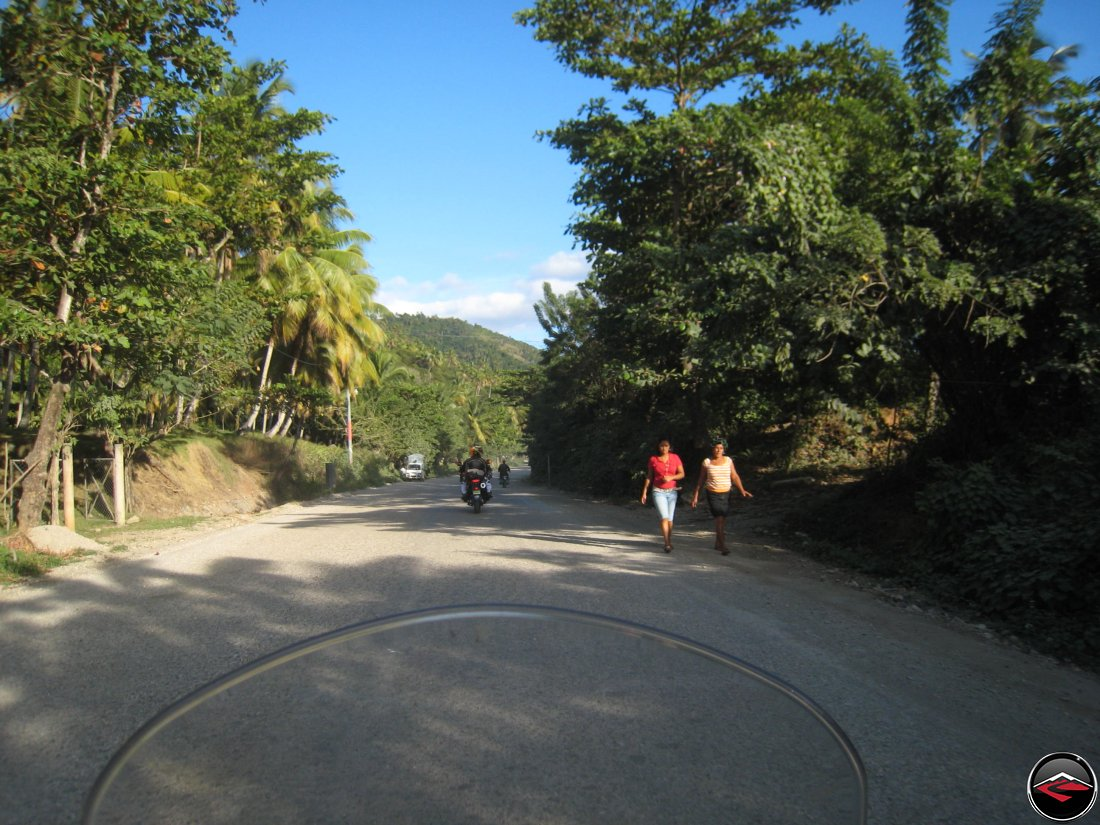 Riding along a road in the dominican republic late in the afternoon