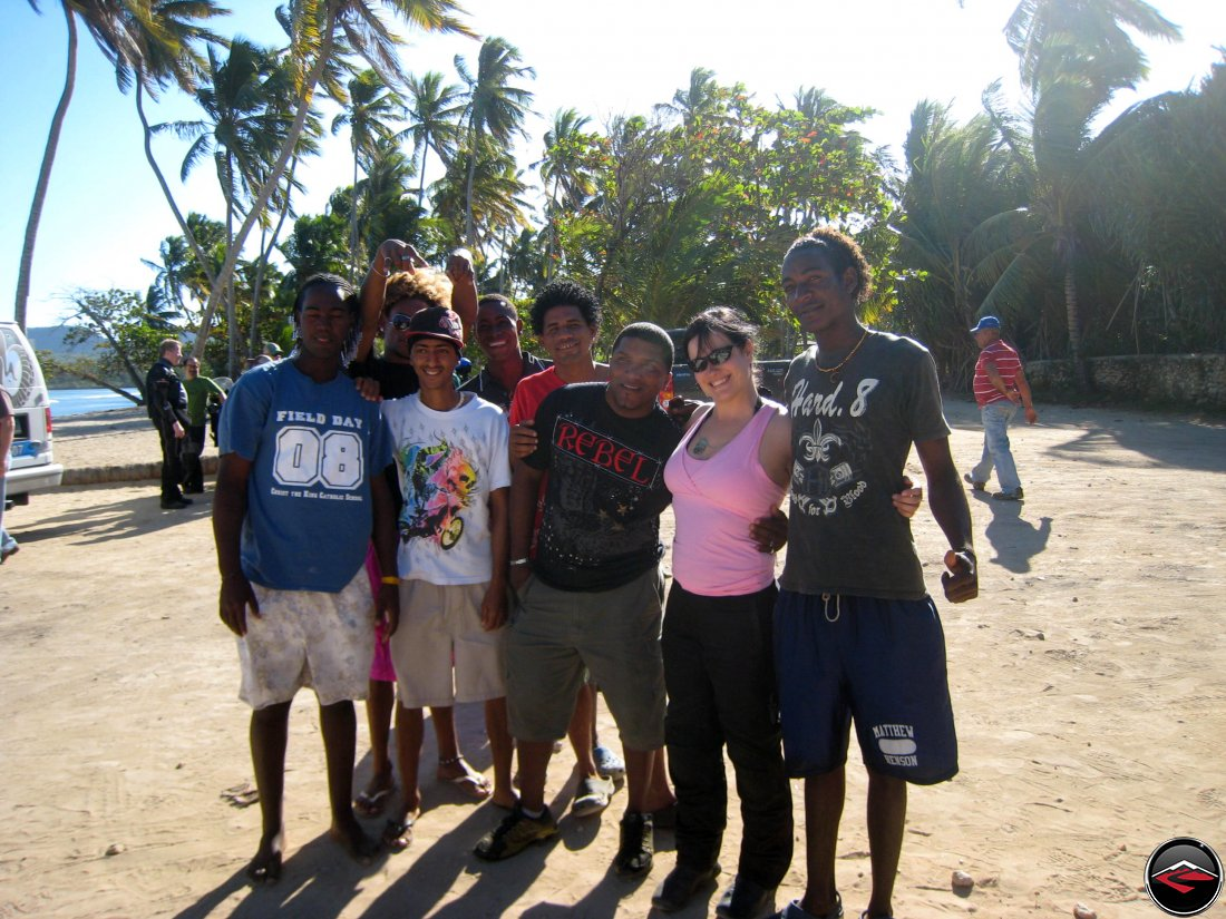 Pretty girl surrounded by Dominican Republic men
