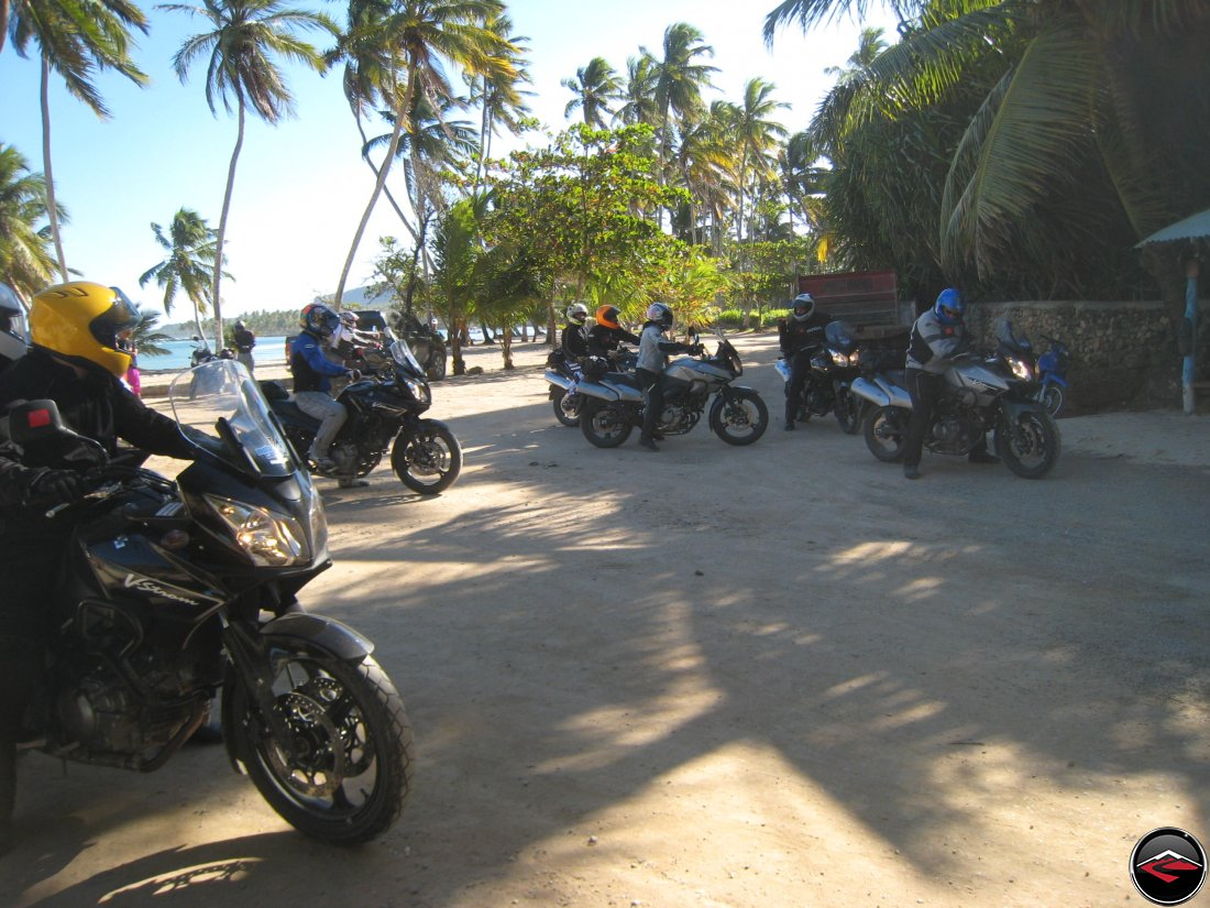 Motorcycles on the beach get ready to go for a group ride