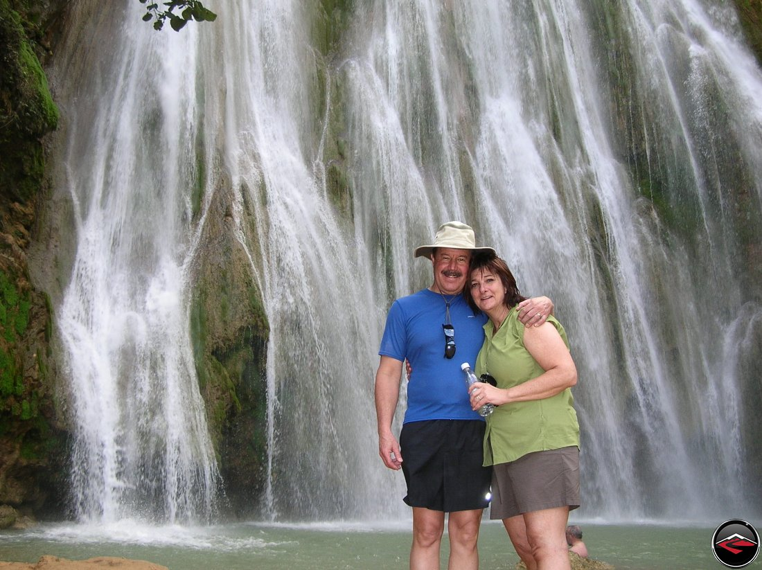 man and woman standing in front of a waterfall Cascada El Limon Dominican Republic
