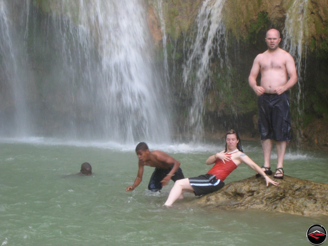 Woman posing like a pirate princess in front of a waterfall Cascada El Limon Dominican Republic