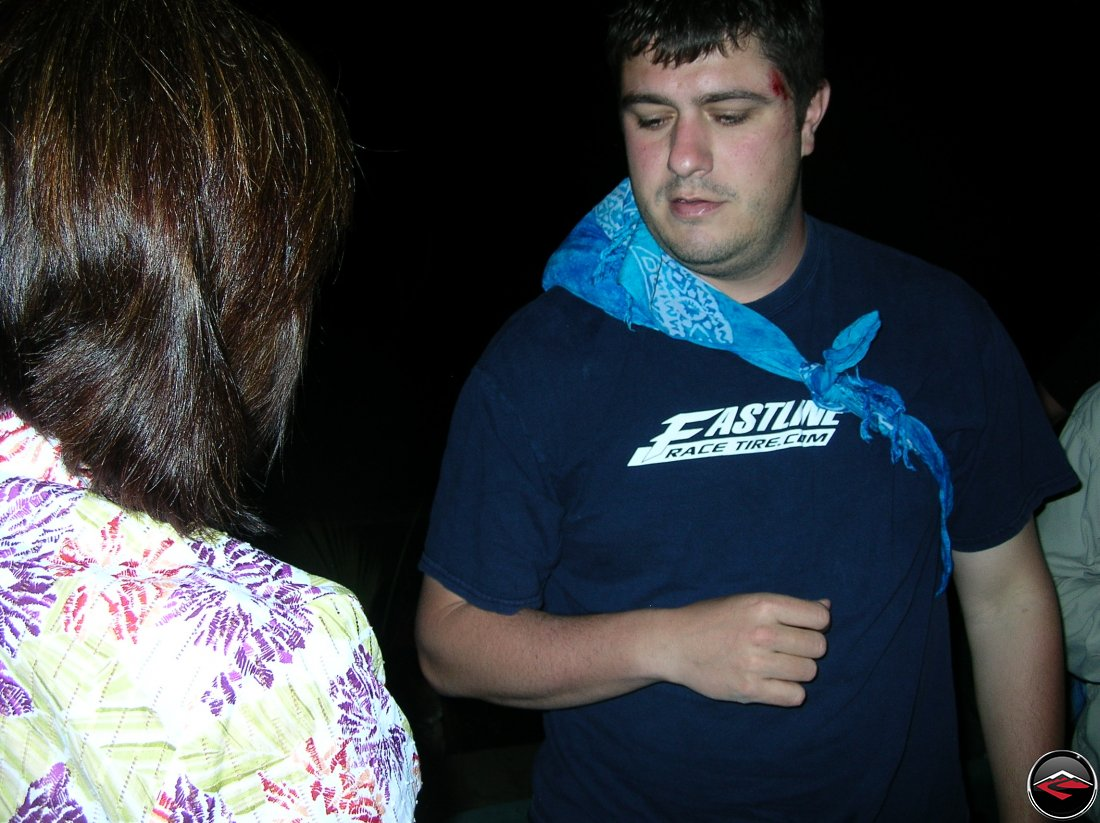 man wearing a sling made from a bandana