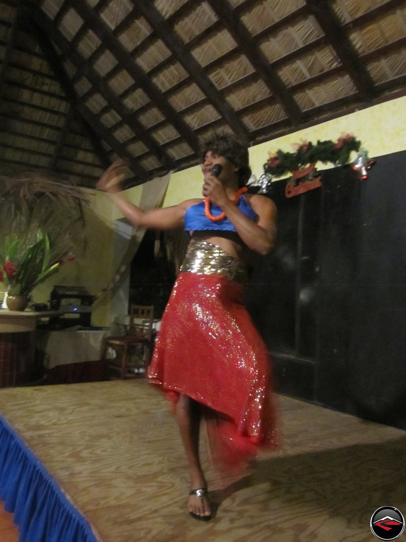 Man dressed as a woman singing to entertain guests La Tambora Beach Resort