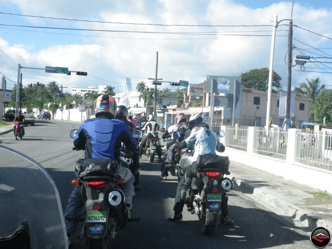 motorcycles stopped at a light in a caribbean town