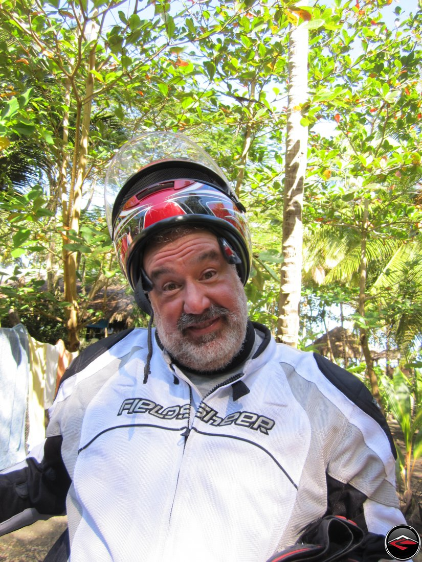 man Playing with his motorcycle helmet