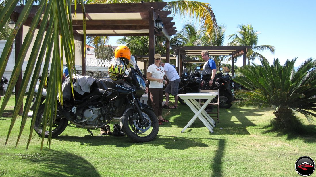 Motorcycles parked near a pergola on perfectly manicured grass lawn