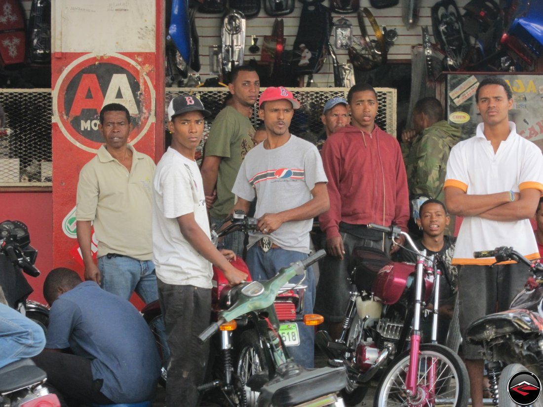 Dominican Republic men being impressed by girls riding motorcycles