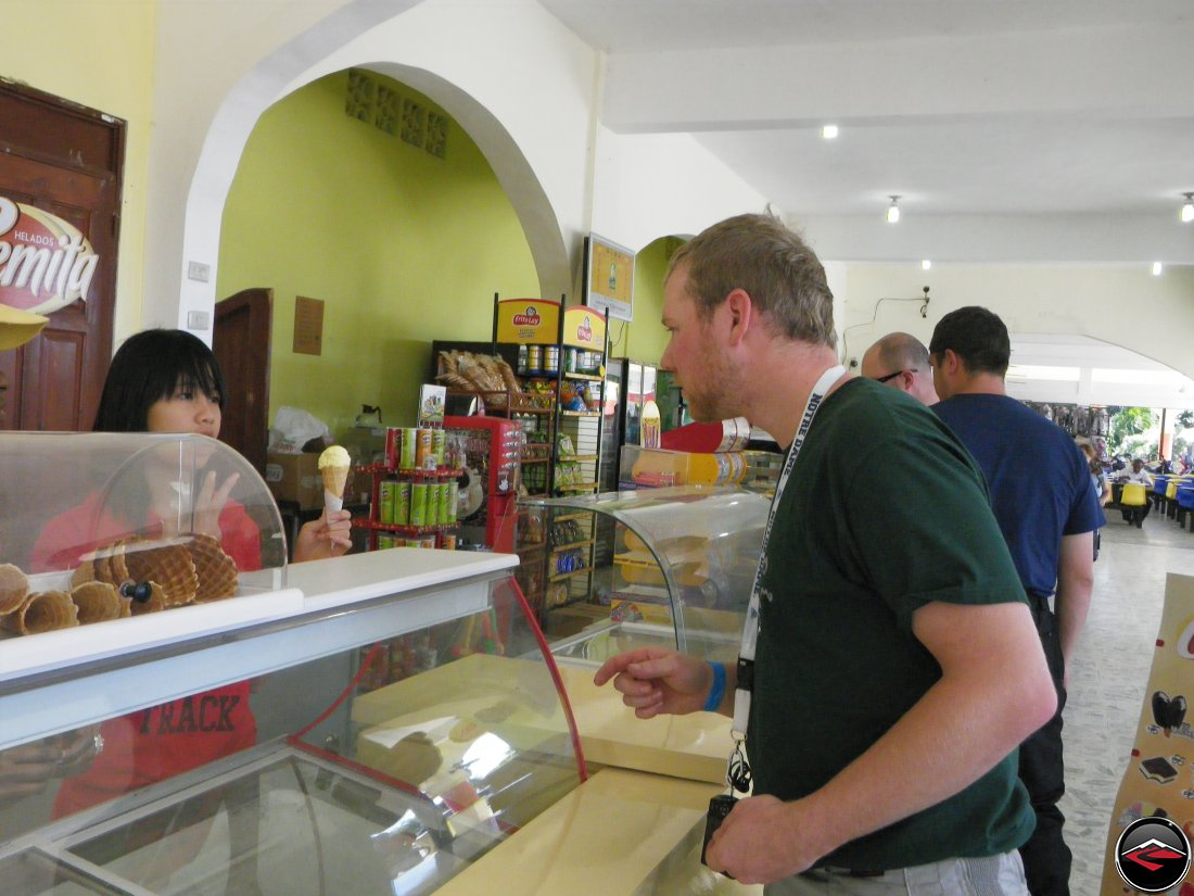 man ordering ice cream at a counter