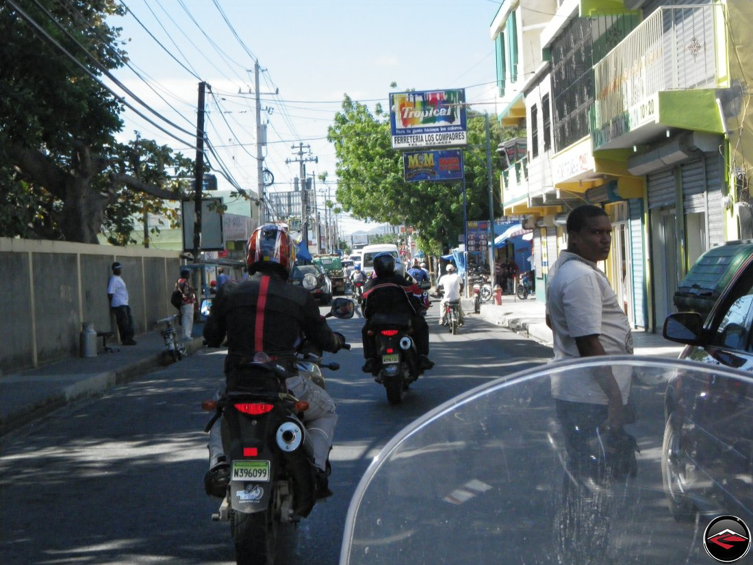 heavy traffic in a small town in the dominican republic, ferreteria los compadres