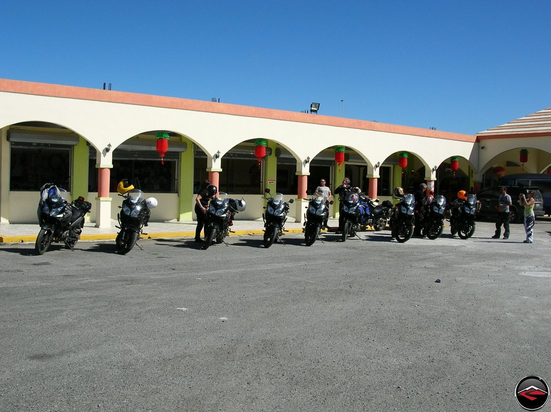 Motorcycles lined up in a parking lot