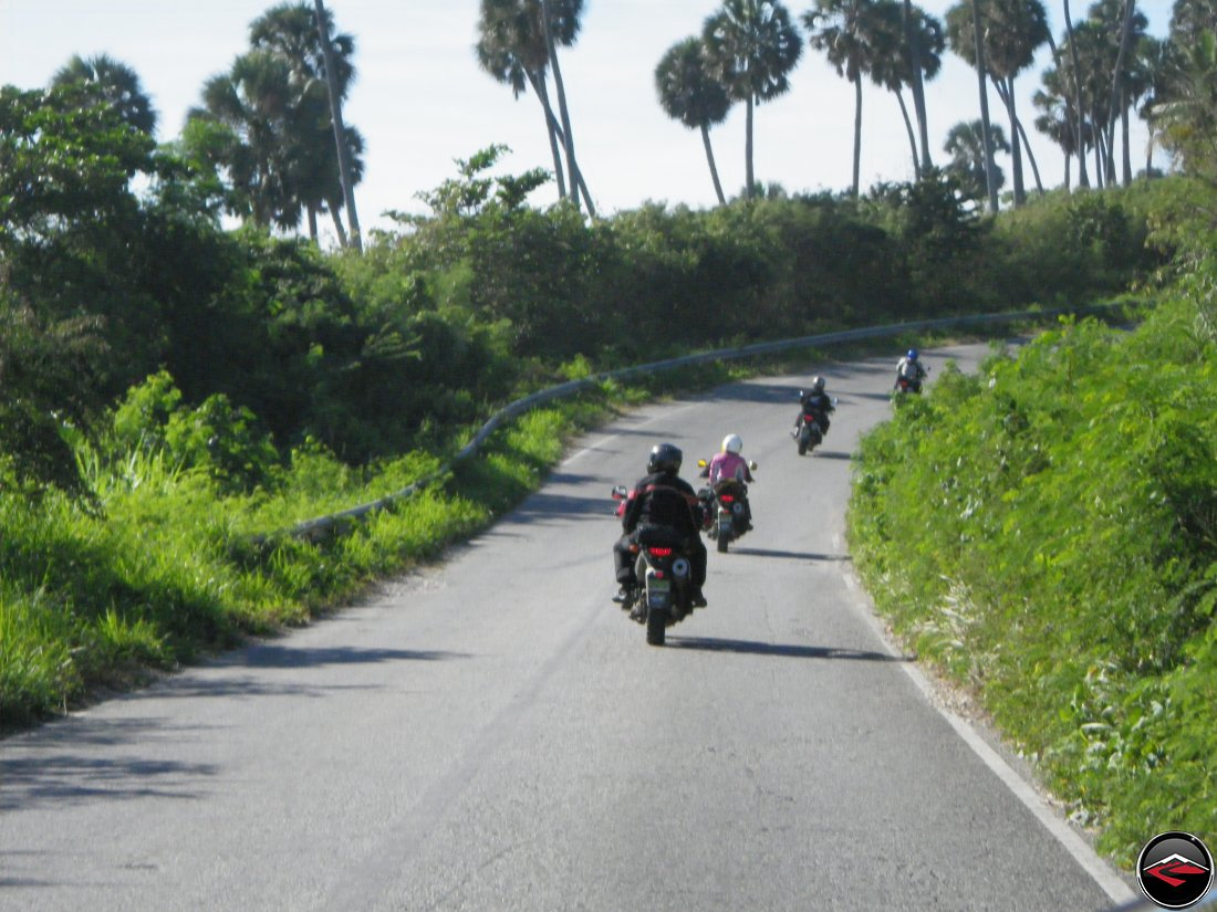 motorcycle riding along the coast line of a caribbean island