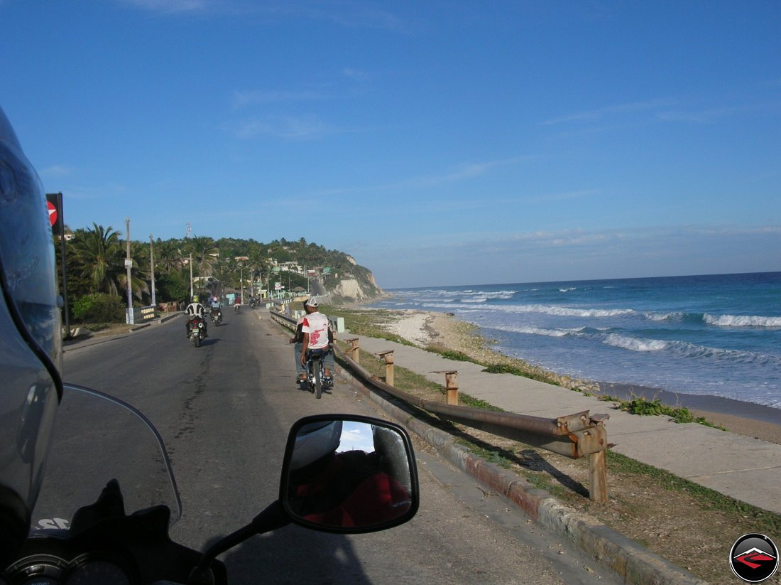 motorcycles riding along the southern coast of the dominican republic during sunset in the caribbean
