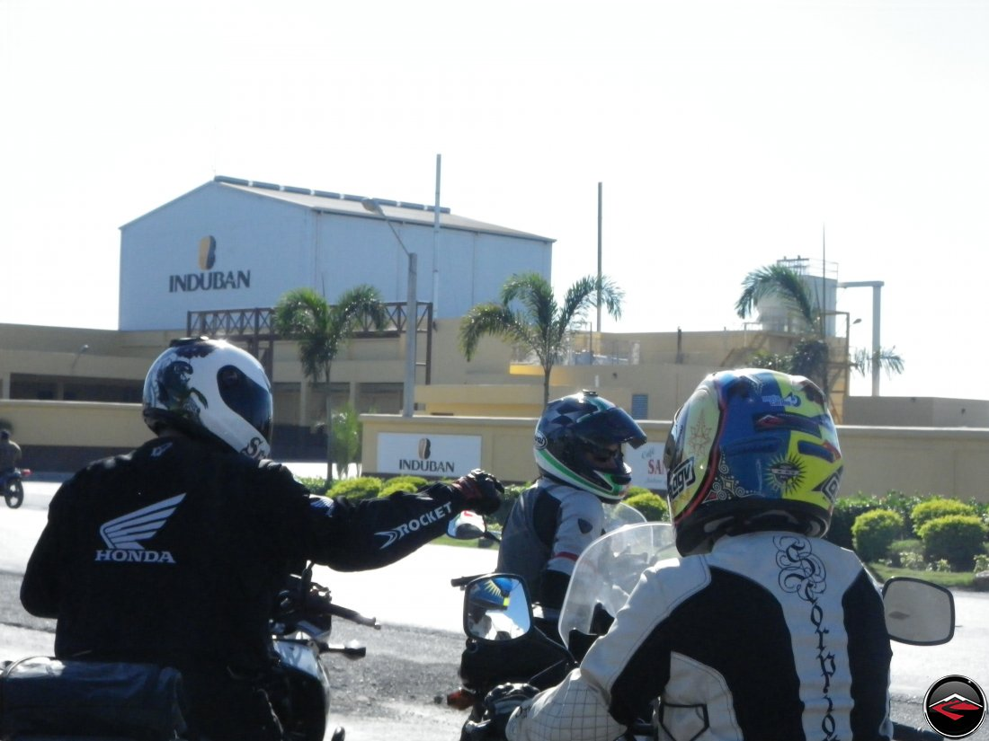 motorcycles stopped in front of industrial building induban