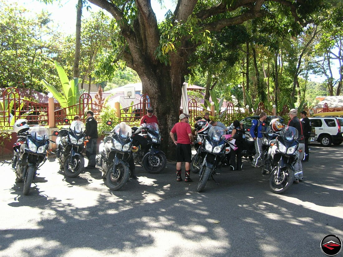 motorcycles parked in the shade in the caribbean