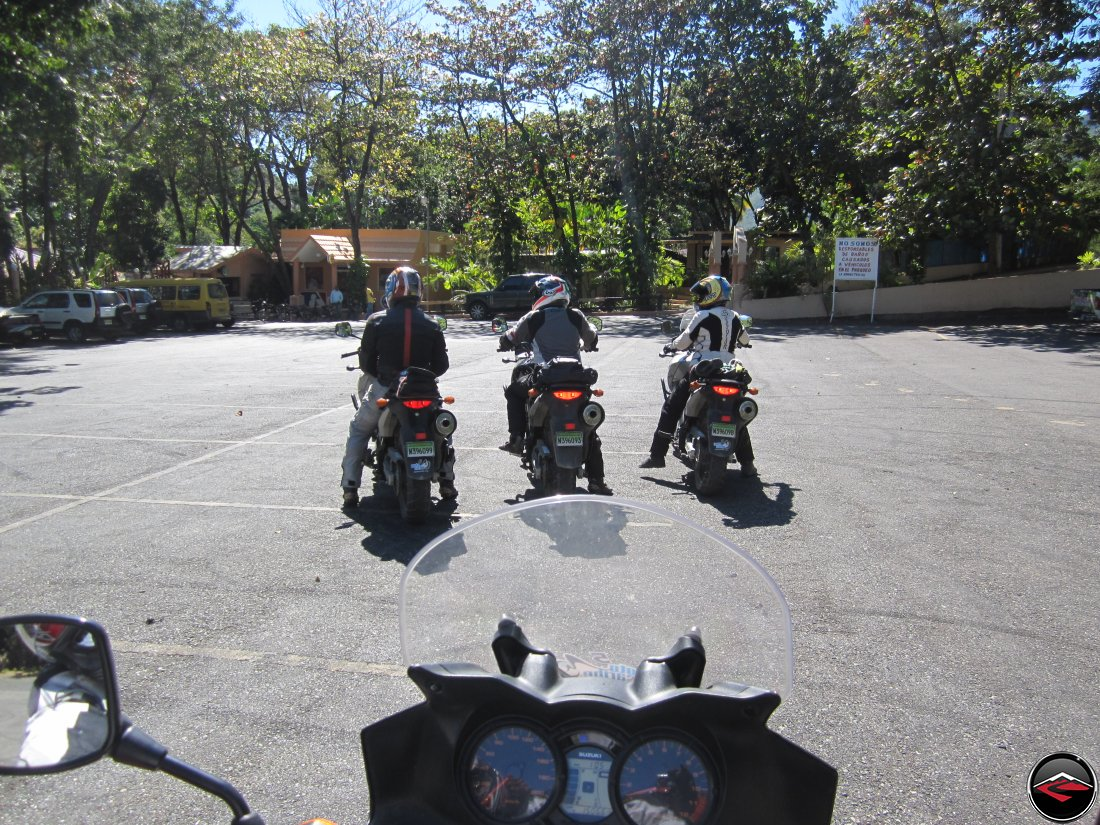 three motorcycles lined up, ready to ride