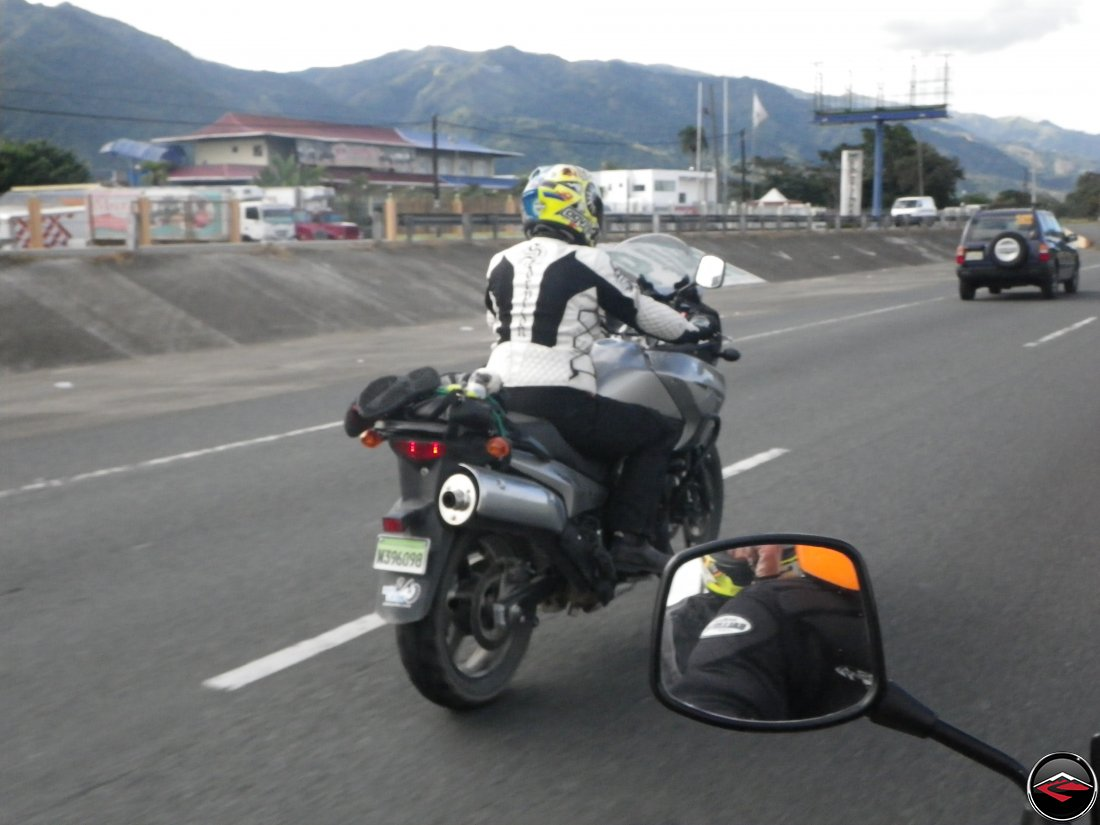 woman riding a motorcycle on the autopista in the dominican republic