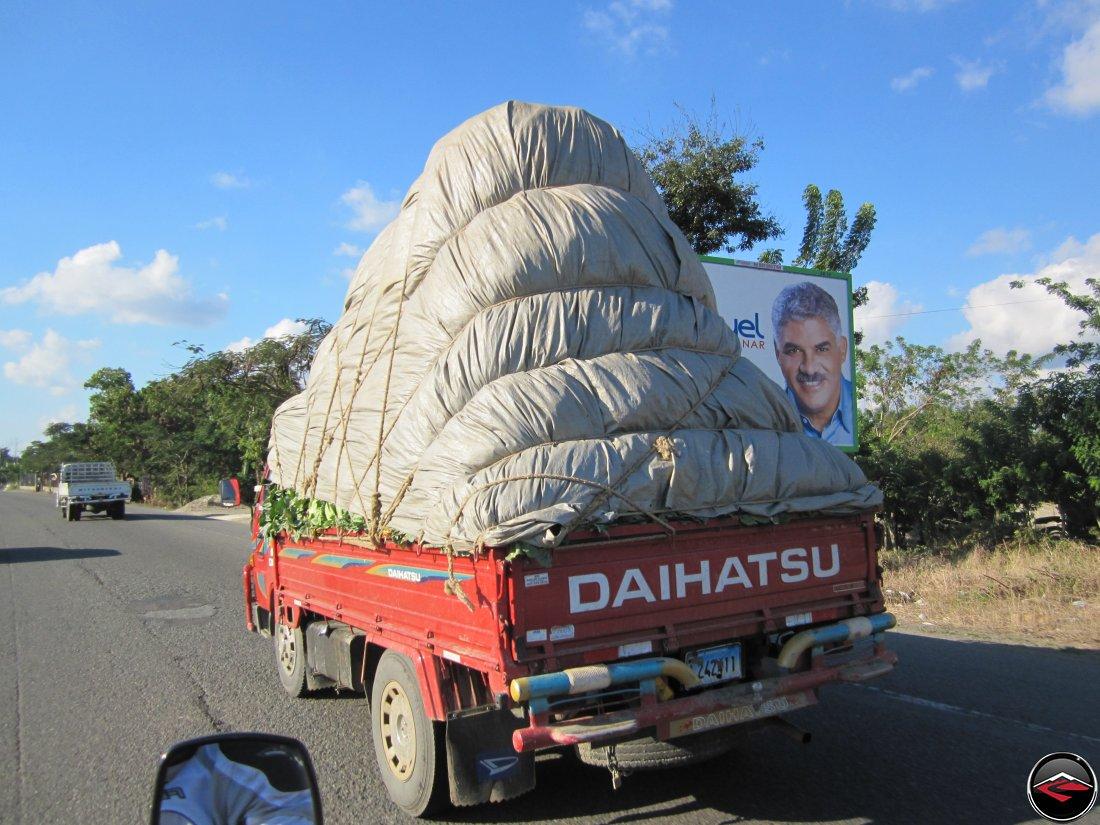 Daihatsu truck hauling very large argicultural load