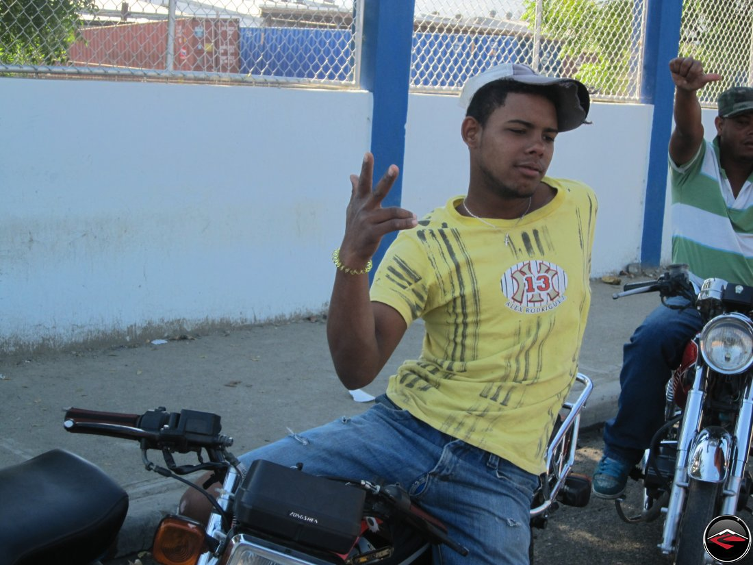 Man striking a funny pose on a motorcycle