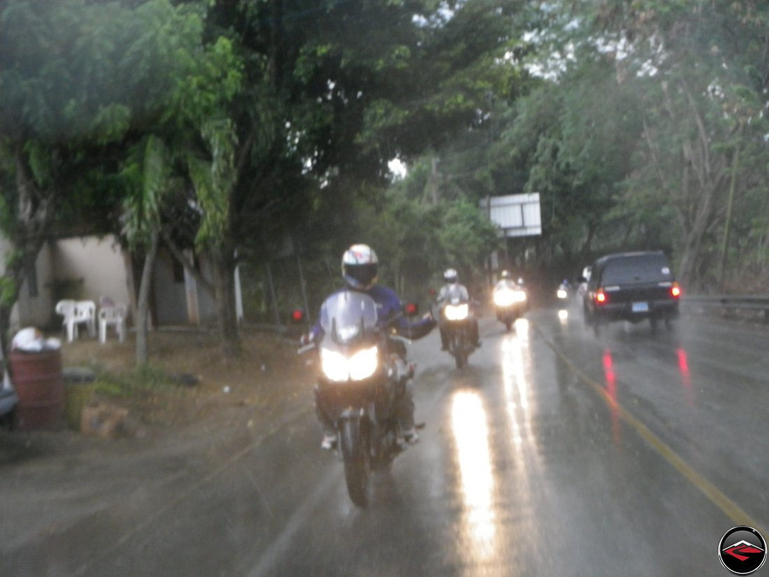 motorcycles riding in the heavy rain