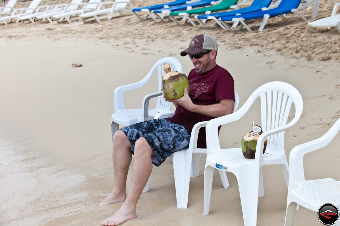man really excited to be drinking a pina coloda made out of a coconut Playa Rincon Dominican Republic