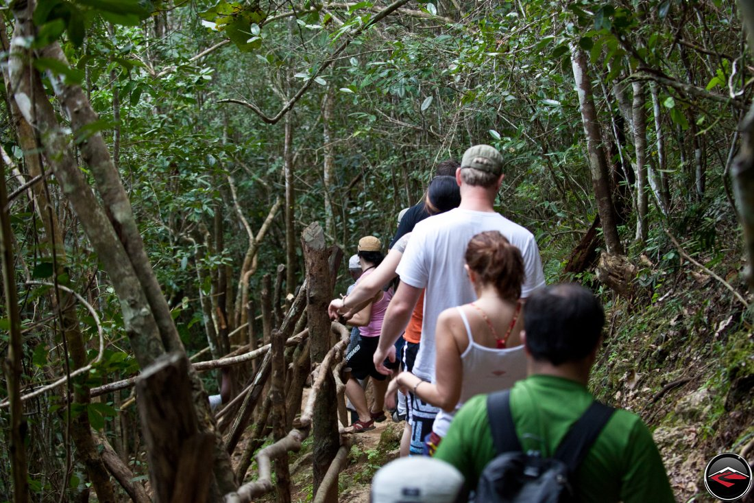 people hiking down to the bottom of the waterfall Cascada El Limon Dominican Republic