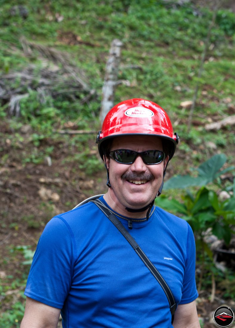 man wearing a silly red helmet Cascada El Limon Dominican Republic