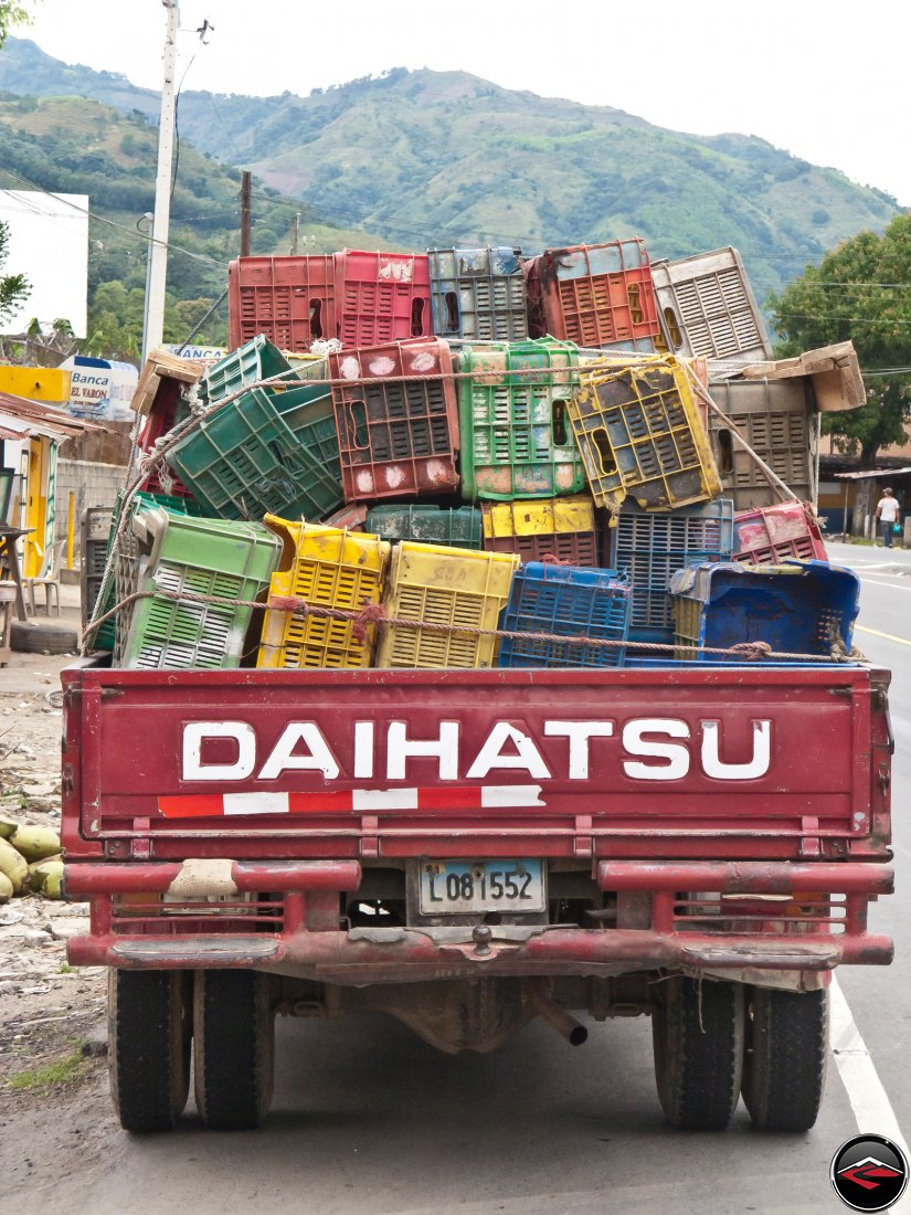 Daihatsu pikcup hauling lots of empty crates
