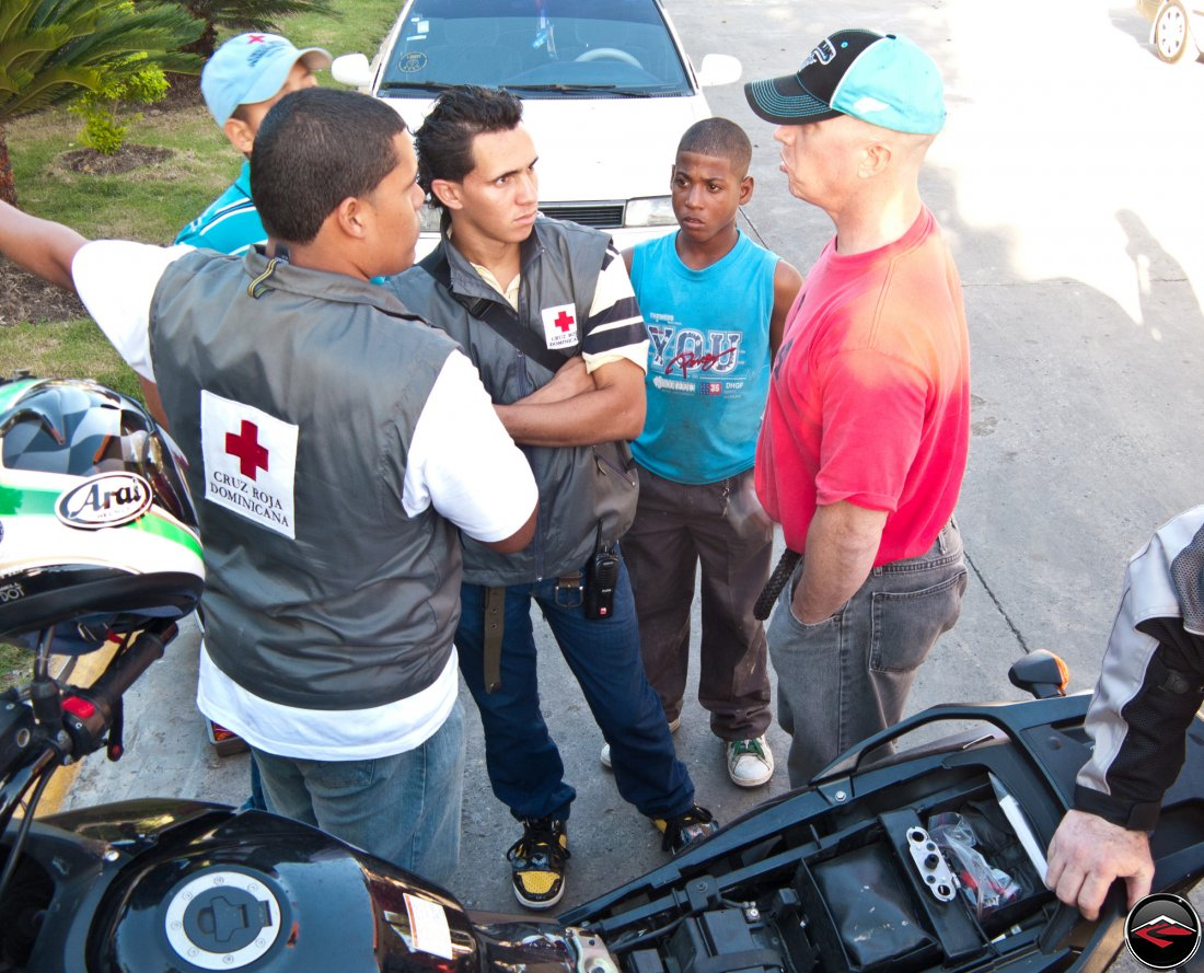 Man talking to Cruz Boja Dominicana medical personnell