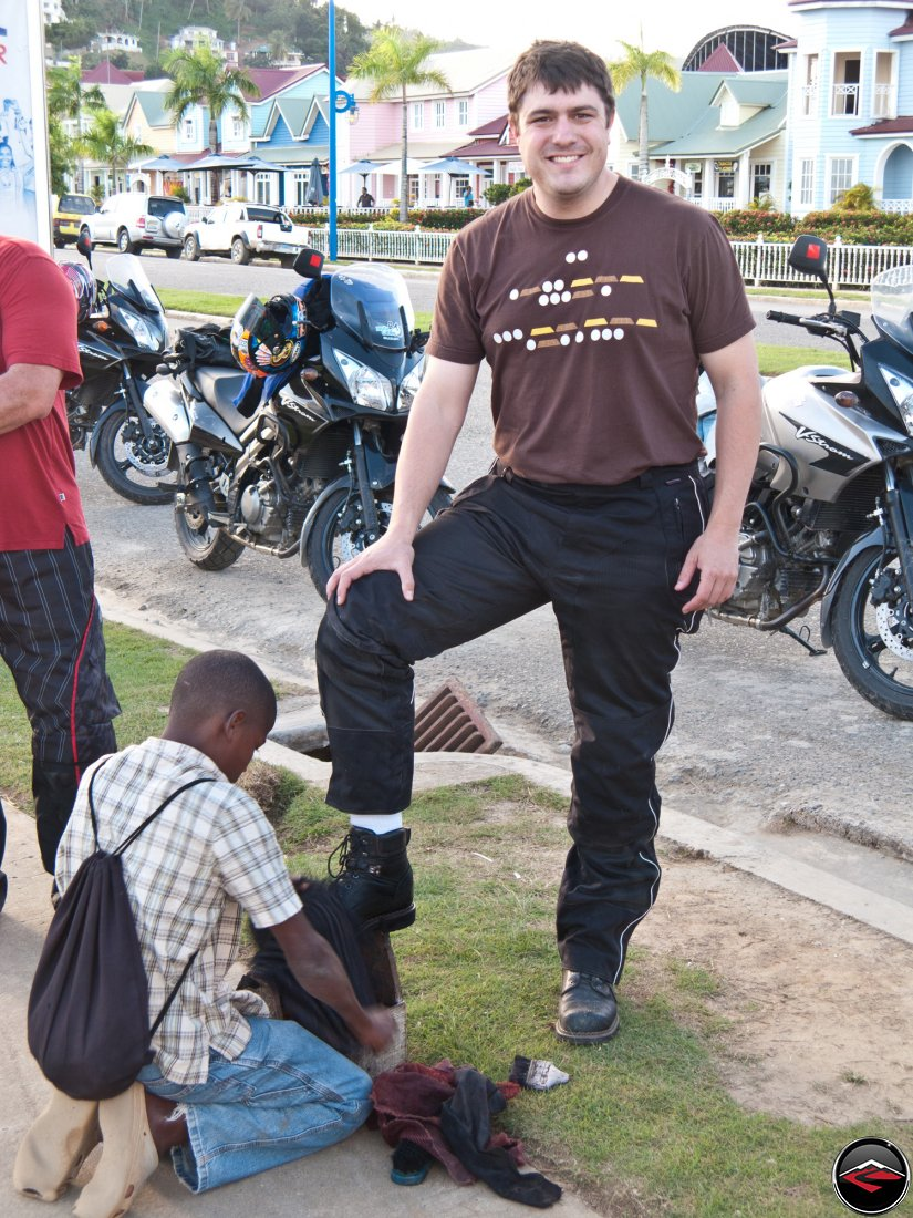 warren getting a shoe shine from local dominican republic boy