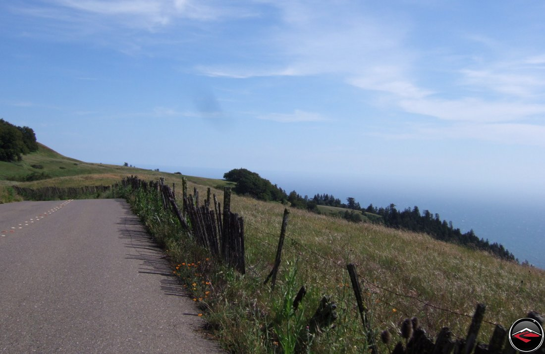Narrow, windy, Pacific Coast Highway in northern California with the Pacific Ocean barely visible behind a layer of fog