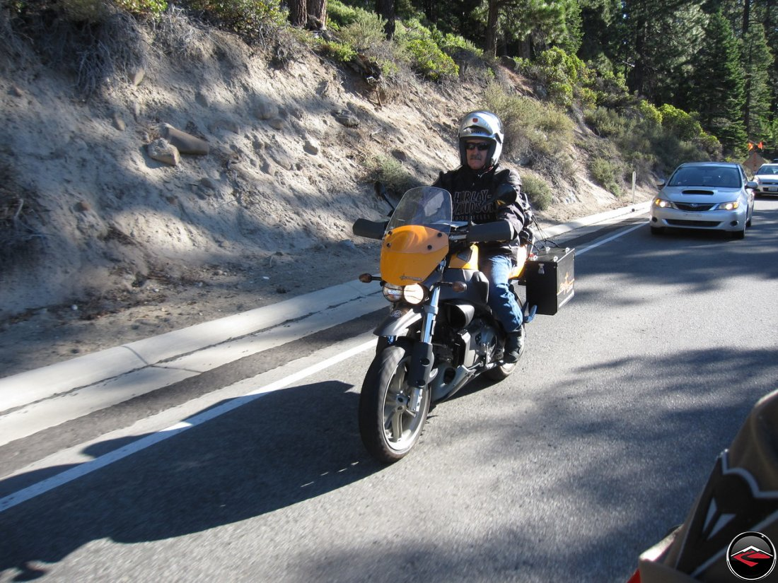 Tom Riding his Buell Ulysses, fit with Pirelli Sync tires and Happy Trails saddlebags, in traffic along California Highway 28, North Lake Blvd, near Lake Tahoe.