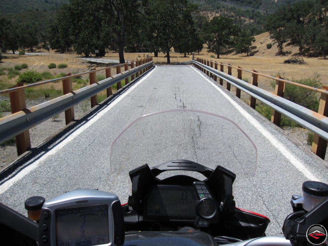 Ducati Multistrada stopped on a single lane bridge along California Highway 130, Del Puerto Canyon Road, while heading to the top of Hamilton Mountain