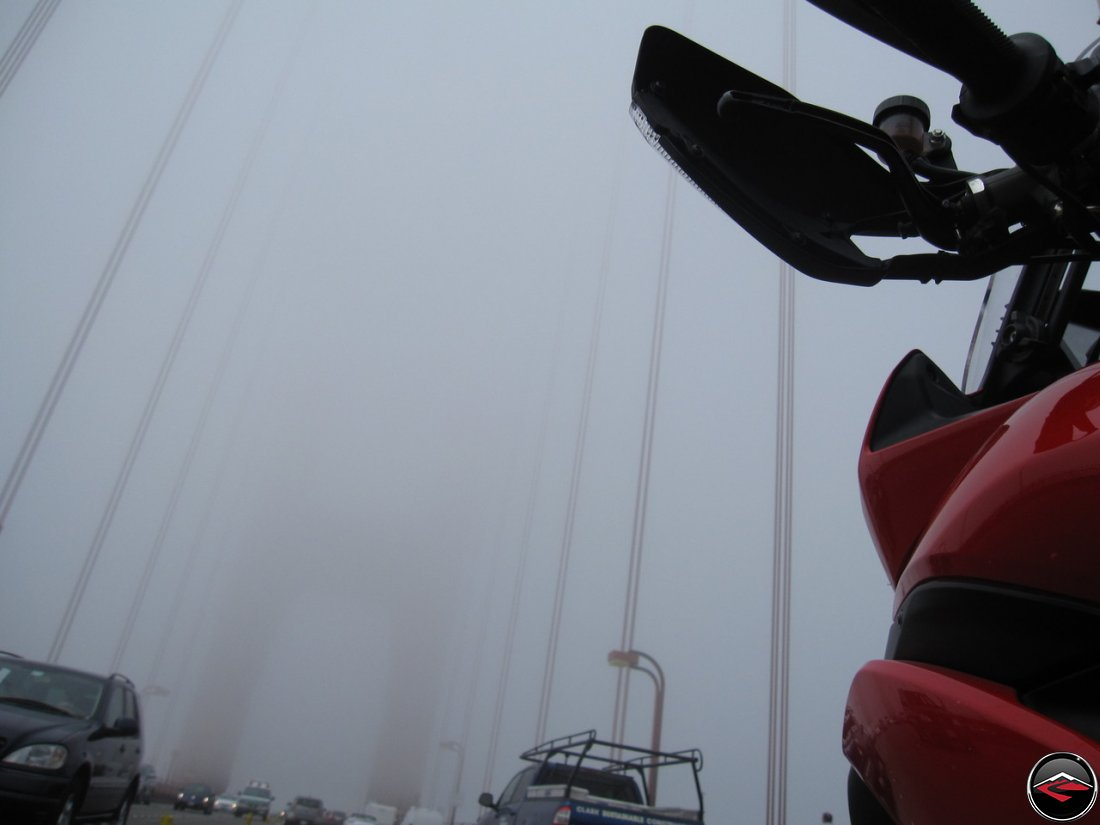 Riding a Ducati Multistrada 1200 motorcycle across the Golden Gate Bridge, in California, in the fog